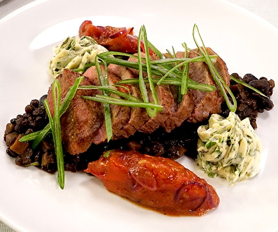 Roast Lamb with Herb Butter, Black Lentils and Tomato Chutney