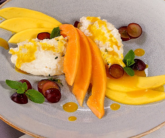 Creamy Coconut Rice Pudding with Passionfruit Sauce